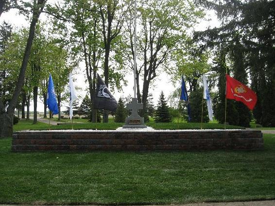 Cemetery Monument with Flags